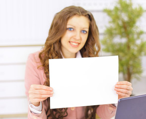 Attractive businesswoman holding a blanket card