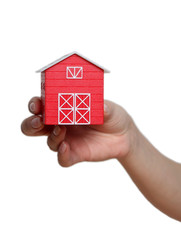 The red house in a hand on a white background