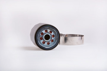 Oil filter and wrench, shallo dof focus on end of filter