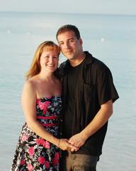 happy couple posing on a tropical beach