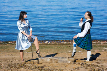 Woman with sword and man in scottish costume