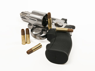 revolver gun and bullet isolated on white background