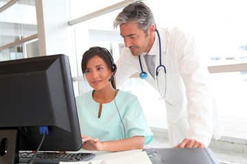 Doctor and nurse working in office