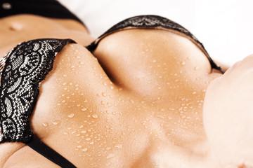 closeup portrait of a female sexy big wet breast