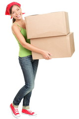 Woman carrying moving boxes