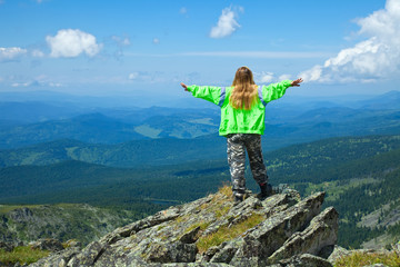 woman  standing at top rock