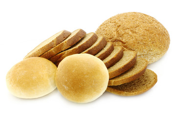 Cut bread and small loaf on a white background