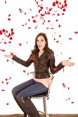 Roses falling around woman