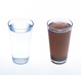 Clean and dirty water in drinking glass - concept