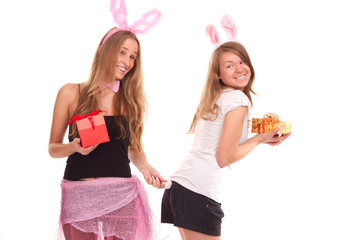 Two girls dressed as a rabbit with gifts