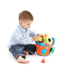 Sweet child with educational toy