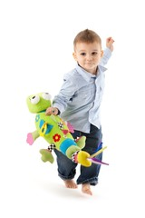 Cute baby boy running with toy