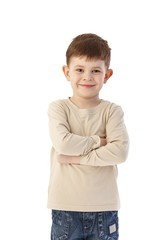 Cute little boy standing arms crossed smiling