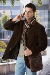 Goodlooking man on phone outdoors