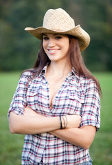 Beautiful smiling cowgirl