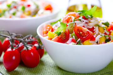 Rice salad with cherry tomatoes, pepper and basil