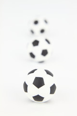 Three footballs on white background