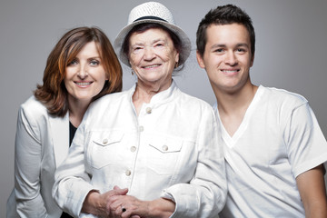 Grandmother with adult daughter and grandson.