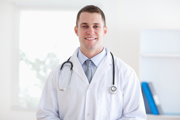 Smiling doctor in his practice