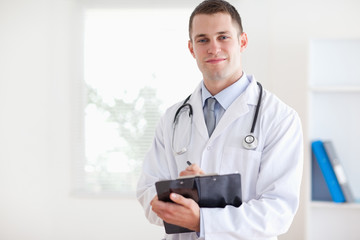 Young doctor taking notes