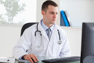 Doctor working on his comptuer