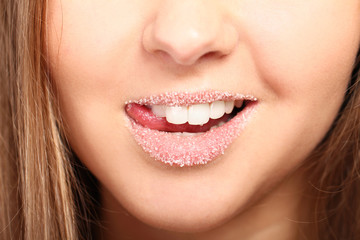 Woman's lips covered with sugar