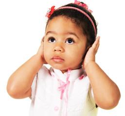 Cute little girl shutting dawn her ears