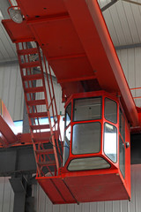 crane operator's cab in a factory workshop