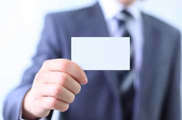 Businessman's hand holding blank paper business