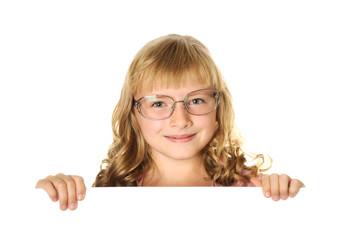 Smiling girl holding white sheet