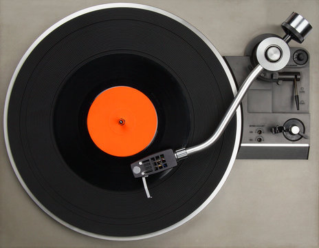 Record player with vinyl record