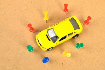 Toy car and push pin