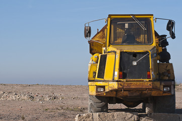 Front view of a yellow Dump truck