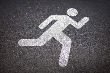 runner sign on asphalt road Wall mural