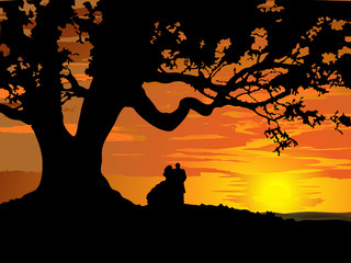 Silhouette of couple in love to tree at sunset