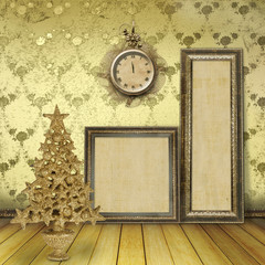 Christmas tree in the old room, with wooden frames for paintings