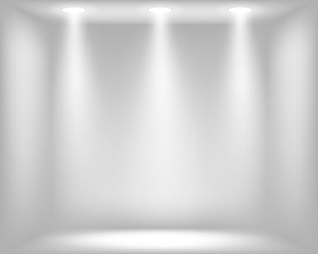 Abstract light grey background with spotlights