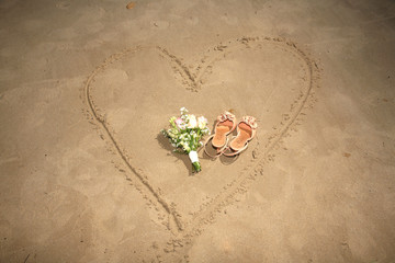 shoes and bouquet on a heart