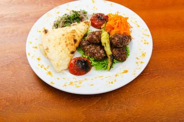 Meat cuisine - kebab served in plate