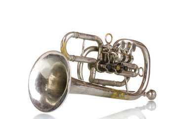 old trumpet isolated on white
