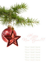 Christmas  star and ball with a pine branch isolated on white