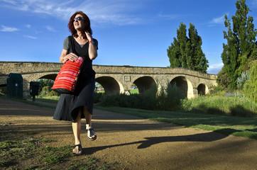 Woman with red bag at Richmond Bridge,Tasmania
