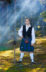 Brave man in scottish costume with sword