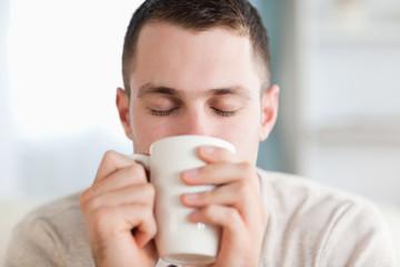 Calm man having a coffee