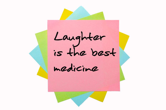 """Proverb """"Laughter is the best medicine"""" written on bunch of stic"""
