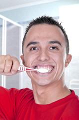 young man brushing his teeth