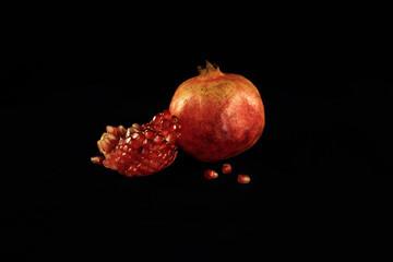 Pomegranate on a black background.
