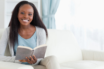 Woman on couch with book