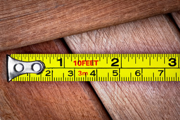Measuring tape over wooden boards