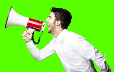 man shouting with megaphone over removable chroma key background